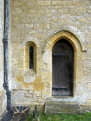 Church of England parish church - 12th-century priest's door and low window of the parish church at Guiting Power, Gloucestershire