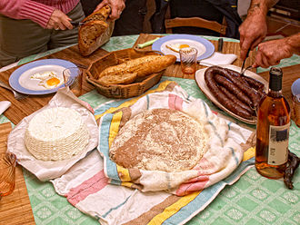 Cuisine of Corsica - A traditional Corsican meal with (from left to right): Brocciu, Pulenda and Figatellu
