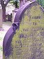 Purple-hued gravestone. (2609489043).jpg