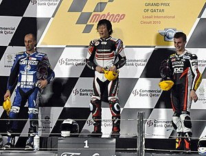 Alex Debón - Debón (left), with Shoya Tomizawa (middle) and Jules Cluzel on the first Moto2 podium at the 2010 Qatar Grand Prix.