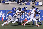 Quarterback Arion Worthman gets tackled as the Air Force Falcons met the Boise State Broncos (31422678313).jpg