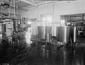 Queensland State Archives 1801 Dairy plant and machinery at the Queensland Farmers Cooperative Dairy Association building Booval Ipswich November 1955.png