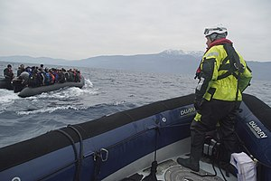 European Border and Coast Guard Agency - Migrants crossing the Mediterranean sea on a boat, heading from the Turkish coast to the northeastern Greek island of Lesbos, 29 January 2016