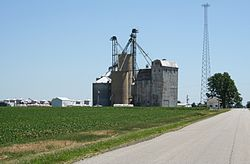 Rising road and the Rising Farmers Grain Company elevator in the southwest corner of section 29.