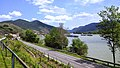 River cruise ships on the Danube near Spitz, Niederösterreich, Austria. The ship on the right is towed by a barge. - panoramio.jpg