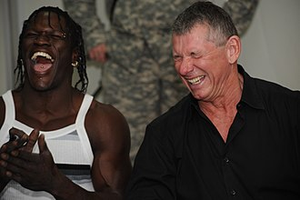 Amusement - Professional wrestlers Vince McMahon (right) and Ron Killings (left) showing amused facial expressions