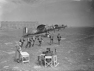 400 Tactical Helicopter Squadron - Crews of 400 Squadron run to their Westland Lysander aircraft during an exercise at RAF Odiham, England, 1941.