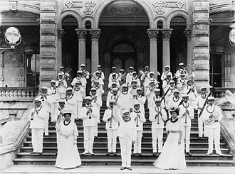 Nani Alapai - Royal Hawaiian Band shown in 1906 with Madame Alapai standing on the left.