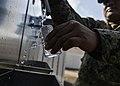 Sailors test Djibouti water quality (11584994534).jpg