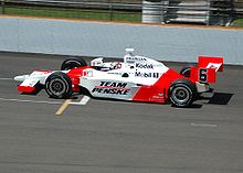 Red-and-white racing car on a track