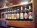 Samuel Smiths bottled beers behind the bar, public bar, Railway Inn, Spofforth, North Yorkshire (4th May 2019).jpg