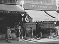 San Francisco, California. A study in contrast in Chinatown, The store on the right is operated by . . . - NARA - 536471.tif