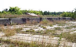 Abandoned concrete gun platforms, formerly par...