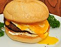Sausage, egg, and cheese on a Kaiser roll.jpg