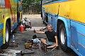 Servicemen repairing buses in Ubon.JPG