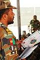 Sgt. Maj. Naqib Abrahami hands out graduation certificate (4782501762).jpg
