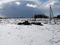 Snow-covered field and snow clouds.jpg