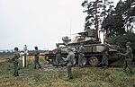 Soldiers of the 11th Armored Cavalry deploying around M551 on Inner German Border with observation towers in background DA-ST-86-06118.jpg