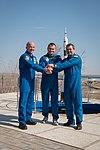 Soyuz TMA-20M crew behind the Cosmonaut Hotel.jpg