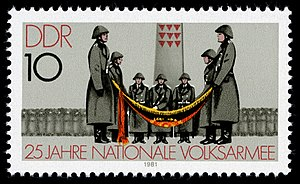 National People's Army - A stamp celebrating 25 years of the NVA. In the background stands a memorial commemorating those who perished in the former Nazi Sachsenhausen Concentration Camp.
