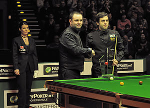 2012 German Masters - Ronnie O'Sullivan and Stephen Maguire behind the trophy before the last session of the final. In the background the referee Michaela Tabb.