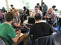 Structured Data on Commons data modelling session at the Wikimania 2019 Hackathon - group discussing copyright modelling.jpg