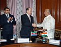 Sushil Kumar Shinde and the Minister of Justice of Azerbaijan, Shri Fikrat Mammadov exchanging the signed documents of the Mutual Legal Assistance Treaty (MLAT) in Criminal Matters, in New Delhi on April 04, 2013.jpg