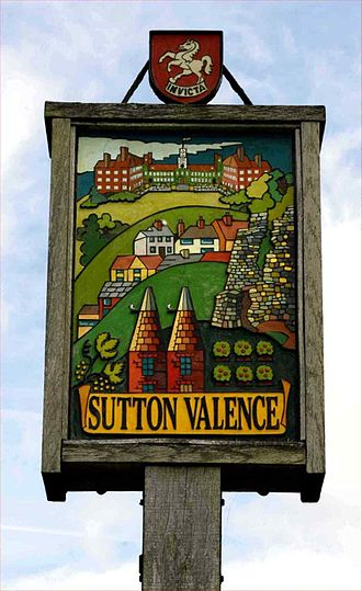 Sutton Valence - Sutton Valence road sign on the A274 showing the school, village, castle and oast houses