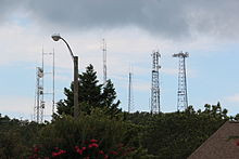 Several tall antennas in a small area