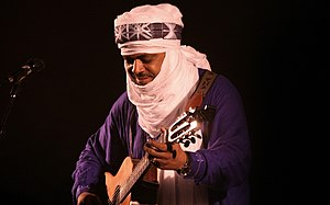 Tinariwen - Abdallah Ag Alhousseyni performing with Tinariwen in Vienna during 2011