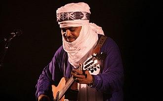Tinariwen - Abdallah Ag Alhousseyni performing with Tinariwen in Vienna during 2011