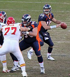 tim tebow playing against the kansas city chiefs in january - Denver Bronco Colors
