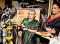 The Chief Minister, Delhi, Smt. Sheila Dikshit lighting the lamp to inaugurate an Exhibition-Cum-Sale of handpicked woven embroidered sarees, shawls, winter wear garments and ethnic jewellery, in New Delhi. The Secretary.jpg