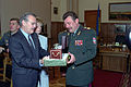 The Honorable Donald H. Rumsfeld, U.S. Secretary of Defense, and the Ukrainian Minister of Defense, General of the Army Olekasander Kuzmuk exchange gifts at Kiev, Ukraine, on Jun. 5, 2001 010605-D-WQ296-061.jpg