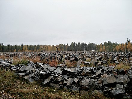 A Winter War monument at Suomussalmi, Finland, containing a rock for every soldier who died at the Battle of Suomussalmi: 750 Finnish and an estimated 24,000 Soviet The Monument of the Winter War.jpg