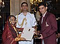 The President, Smt. Pratibha Devisingh Patil presenting the Arjuna Award for the year-2011 to Shri Veerdhawal Vikram Khade for Swimming, in a glittering ceremony, at Rashtrapati Bhavan, in New Delhi on August 29, 2011.jpg