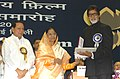 The President, Smt. Pratibha Devisingh Patil presenting the Best Film Actor Award for the year 2005 to Shri Amitabh Bachchan.jpg