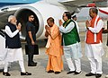 The Prime Minister, Shri Narendra Modi being welcomed by the Chief Minister of Uttar Pradesh, Yogi Adityanath and other dignitaries, on his arrival, at Varanasi, Uttar Pradesh on November 12, 2018.JPG