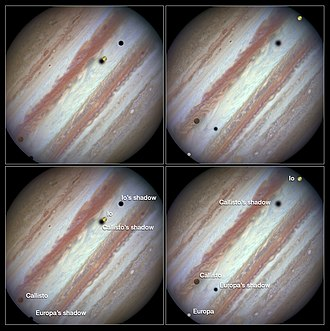 Shadow - Three moons (Callisto, Europa and Io) and their shadows parade across Jupiter.