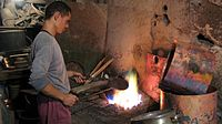 Tinsmith working in Tripoli or Medina.jpg