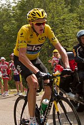 Chris Froome wearing a yellow cycling jersey.