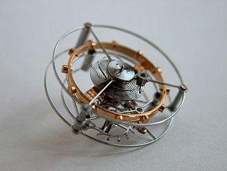 Tourbillon - An assembled tourbillon, clearly showing balance wheel, pallet fork and escape wheel.