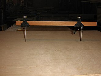 """Beam compass - sharp point used to score a fine line in the birch plywood connected to each other by a piece of 3/4"""" X 3/8"""" mahogany"""