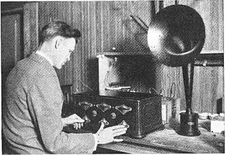 Tuned radio frequency receiver - Tuning all 3 stages of a TRF set in unison. This 1925 Grebe Synchrophase receiver has thumbwheels instead of knobs which can be turned with a finger, so a third hand is not needed.
