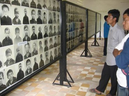 Rooms of the Tuol Sleng Genocide Museum contain thousands of photos taken by the Khmer Rouge of their victims. TuolSlang3.jpg