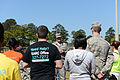 U.S. Air Force Col. Christopher Hill, the commander of the 78th Air Base Wing, speaks to Team Robins members during the Walk A Mile In Their Shoes event at Robins Air Force Base in Warner Robins, Ga., April 10 140410-Z-XI378-003.jpg