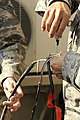 U.S. Airmen works on the wiring of a solar powered light at Bagram Airfield, Afghanistan, Feb. 23, 2010 100223-F-PI632-153.jpg