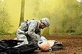 U.S. Army 1st Lt. Jeff Arruiza with the 758th Forward Surgical Team, 47th Combat Support Hospital, applies a chest covering to a casualty as part of the training lane for the Expert Field Medic Badge at Joint 130409-A-CD114-505.jpg