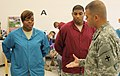U.S. Army Sgt. Maj. Grant Dupoux, right, the operations senior enlisted adviser of the 332nd Medical Brigade, based out of Nashville, Tenn., presents a brigade coin to Spc. Carnisha Reed, a dental assistant with 140620-A-VL725-003.jpg