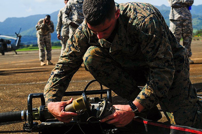 File:U.S. Marine Corps Cpl. Christian Baxter, a bulk fuel specialist with the Marine Wing Support Detachment based in Marine Corps Base Hawaii, attaches a fuel hose to a motor while constructing the micro-Forward 131118-A-UG106-275.jpg